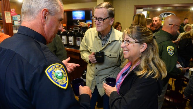 Then Capt. Jeff Newton of the Great Falls Police Department visits with Miike Hart and his wife Nancy Slabaugh-Hart during the Coffee with a Cop community event at Schulte's Coffee House in 2015. Newton said during his presentation Tuesday that Coffee with a Cop would be a program he'd like to see reinstated as the community starts to return to pre-pandemic activities.