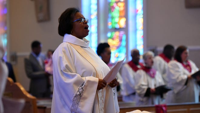 The Rev. Michelle White leads an Easter service at Christ Episcopal Church in Teaneck on Sunday.