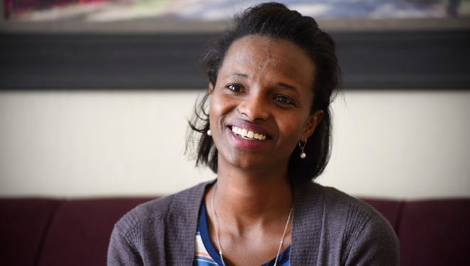 Technical High School teacher Ayan Omar talks about how she uses her writing to bring an understanding of Islam and the Somali culture during an interview Friday, June 16, at her home in St. Cloud.