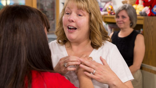 Donna Harper (left)  the mother of Matthew Boylen, greets Lucy Boenitz, Indianapolis. It was their first meeting since Boenitz received the transplanted heart of Boylen 11 years ago, Indianapolis, Saturday, Sept. 16, 2017.