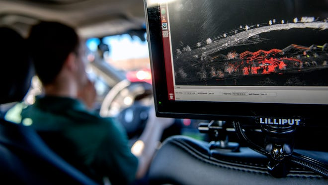 A real-time read out of the light, detection and ranging mapping technology is displayed on a monitor during a demonstration of the self-driving car in a parking lot near the MSU Foundation building on Wednesday, Nov. 29, 2017, in East Lansing. The vehicle is being used to further the development of autonomous vehicles.