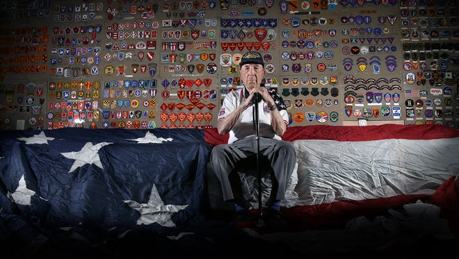 """World War II, Korean War and Vietnam War veteran retired Army Lt. Col. Robert E. """"Bob"""" Chisolm sits with a military patch collection donated to Roy Benavidez-Robert Patterson """"All Airborne"""" Chapterof the 82nd Airborne Division Association by the family of charter member Maynard L.""""Beamy"""" Beamesderfer."""