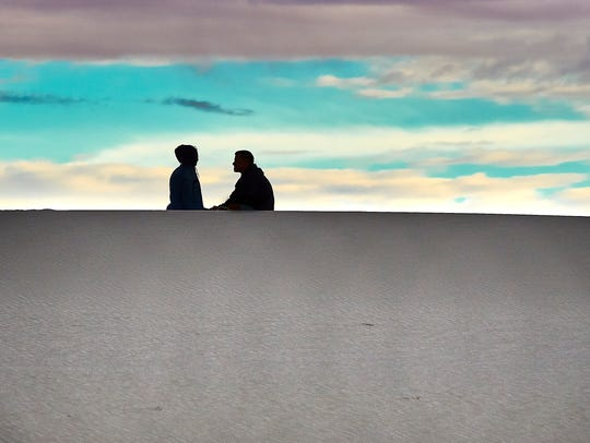 "Dick Beery: ""The vastness of the desert in contrast to the two people enjoying each other gave meaning to this photo: White Sands, New Mexico."" Dick Beery is an electronics engineer whose life and photography are guided by his motto: ""Never grow up and never stop learning!"""