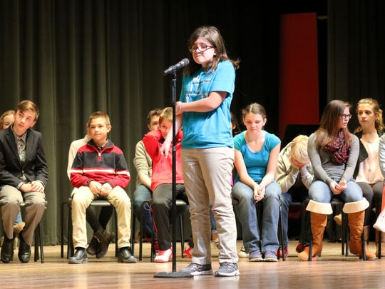 Alyssa Libben, of Port Clinton Middle School, thinks before spelling 'physicist,' the word that sealed her first-place finish in the school spelling bee Wednesday.