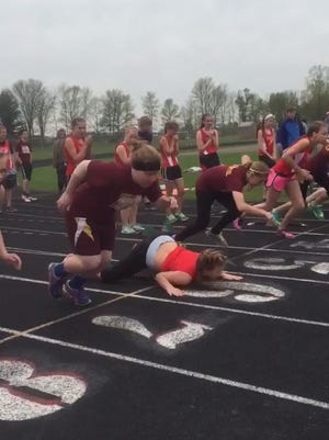 A video of Makenna Kroge (middle) stumbling at the starting line has gone viral.