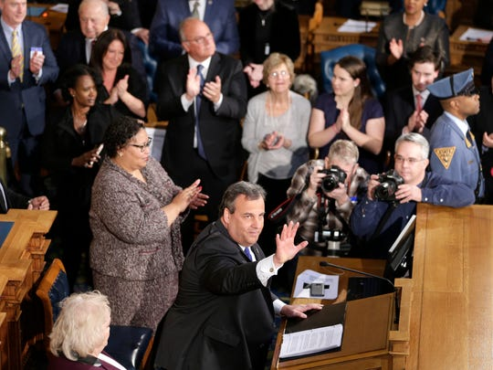 New Jersey Gov. Chris Christie, bottom, waves to lawmakers