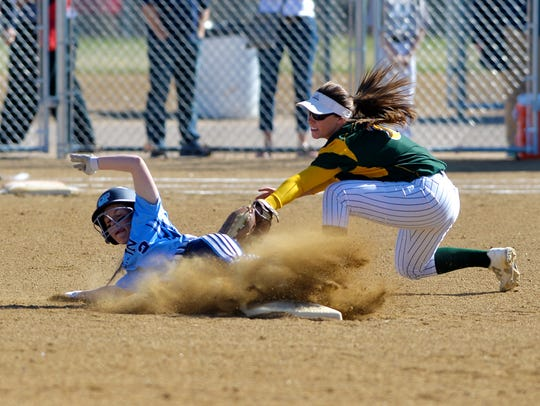 Great Falls High's Sarah Conway attempts to steal second