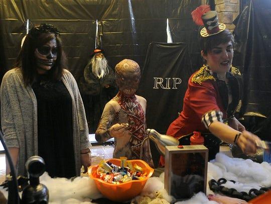 (From left) Raeanne Webb, Kindred Robinson, 10, Monica