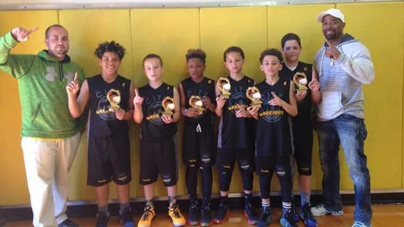 The Western North Carolina Warriors fifth-grade AAU boys basketball team won the Battle of the Hoops tournament last weekend in Johnson City.