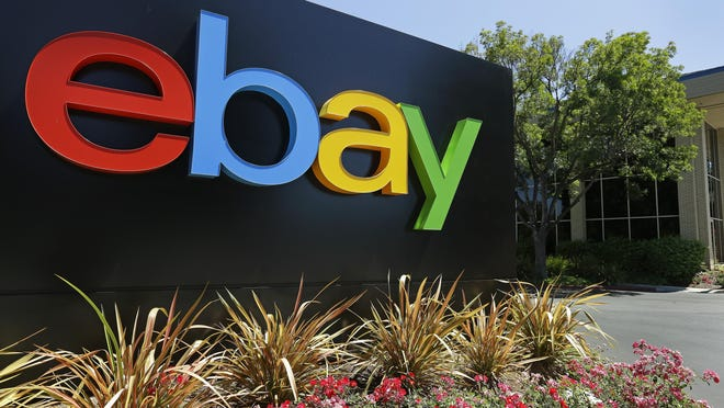 FILE - This Tuesday, July 16, 2013, file photo shows signage at eBay headquarters in San Jose, Calif. Six former eBay Inc. employees were arrested and charged Monday, June 15, 2020, with waging an extensive campaign to terrorize and intimidate the editor and publisher of an online newsletter with threats and disturbing deliveries to their home, including live spiders and cockroaches.