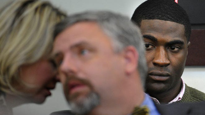 Defendant Cory Batey, right, looks on as defense attorneys confer during the Vanderbilt rape trial on Friday.