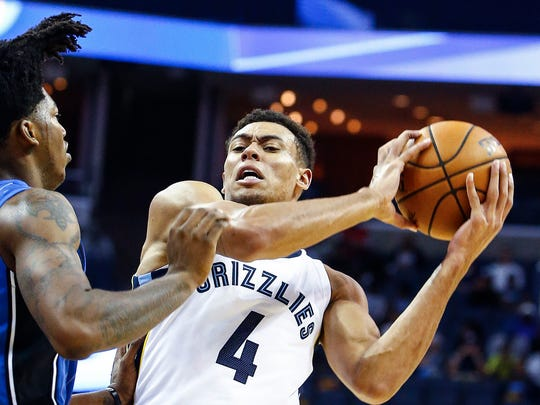 Memphis Grizzlies guard Wade Baldwin IV (right) drives the lane against the Orlando Magic defender Elfrid Payton (left) during first quarter action at the FedExForum in Memphis, Tenn., Monday, October 2, 2017.