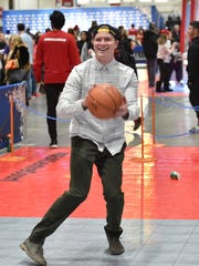 Josef Newgarden shoots hoops at NBA Centre Court at Enercare Centre during NBA All-Star Weekend in Toronto.