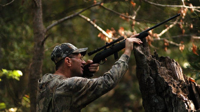 Using a .22 rifle to hunt squirrels means needing a solid rest before you shoot. There is no closed season or bag limit on squirrels in Central Texas.
