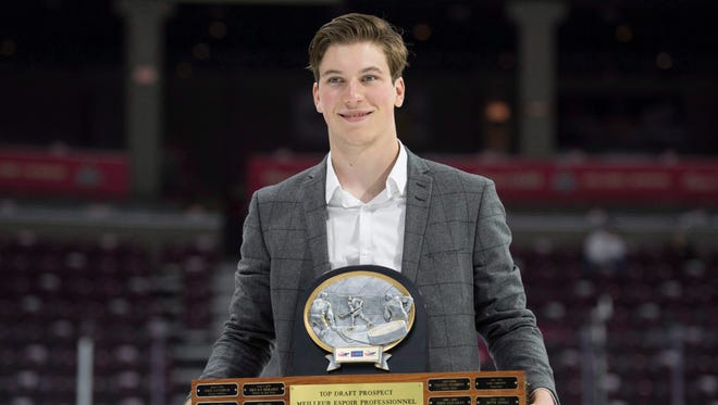 Nolan Patrick, shown with the  Top Prospect Award, is considered the best talent in the NHL draft.