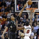 Milwaukee Bucks forward Khris Middleton (22) in the first quarter at American Airlines Arena.