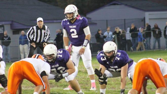 Glen Este senior quarterback Tyler Pilcher runs the Trojan offense against Anderson.