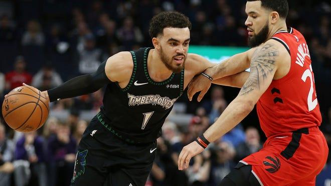 Minnesota Timberwolves' Tyus Jones drives the ball around Toronto Raptors' Fred VanVleet in the first half of an NBA basketball game Tuesday April 9, 2019, in Minneapolis. (AP Photo/Stacy Bengs)