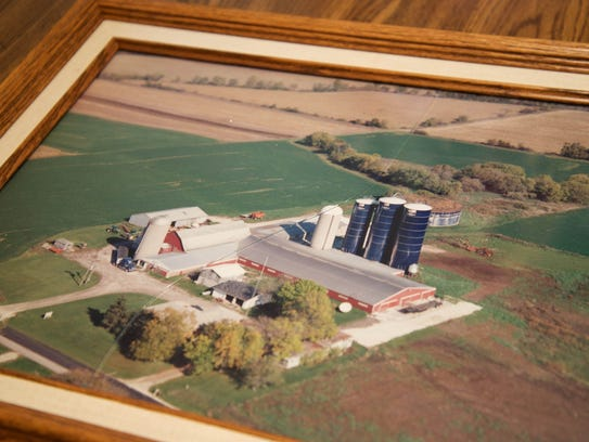 A framed photo of the Welch farm at its largest and