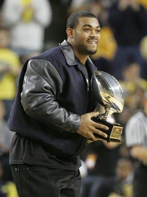 Ex-Michigan football player Brandon Graham visiting a U-M basketball game in 2010.