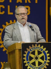 Brent Henley, a practicing industrial psychologist, speaks to the Rotary Club of Alexandria Tuesday.