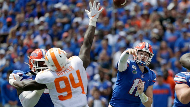Florida quarterback Kyle Trask throws a pass over Tennessee defensive lineman Matthew Butler during the first half of last year's game in Gainesville.