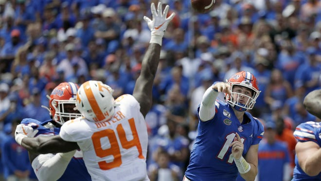 Florida quarterback Kyle Trask throws a pass over Tennessee defensive lineman Matthew Butler during their game last year. The Gators are ranked No. 8 in this year's Associated Press Top 25 poll, but they received 11 top-five votes.