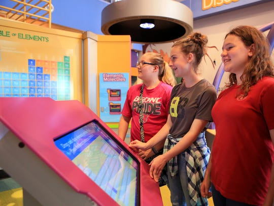 Baker Middle School students Maylee Johnston (from left), 12, Abigail Fields, 13, and Alexis Spencer, 13, explore the chemistry in action exhibit at the Corpus Christi Museum of Science and History on Wednesday, April 19, 2017. The museum recently won an award for the interactive science exhibit.