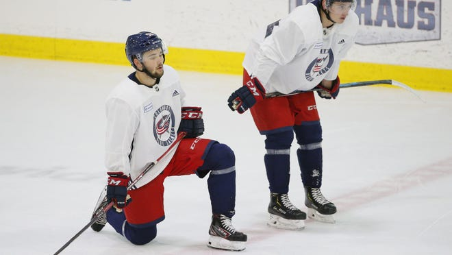 Forwards Emil Bemstrom, left, and Alexandre Texier, shown in June 2019, are being lent by the Blue Jackets to teams in Finland's top league for its regular season, which begins Oct. 1.