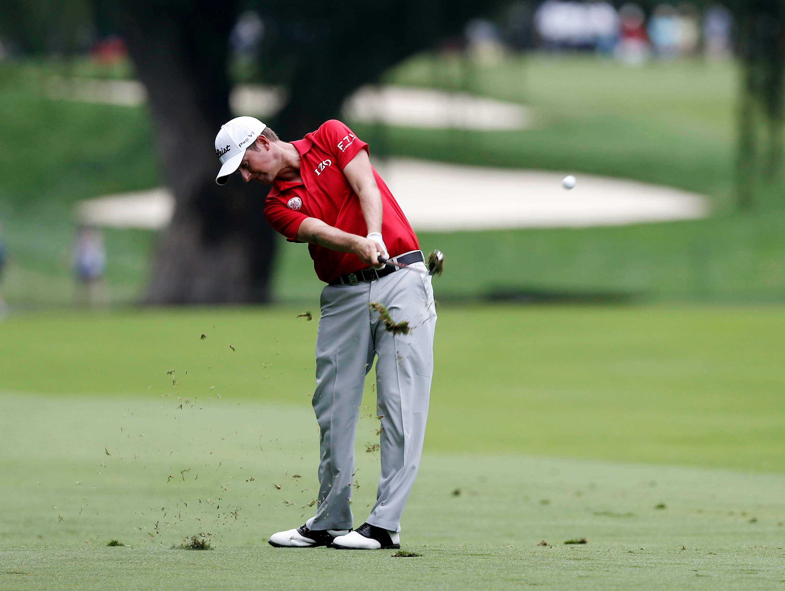 Webb Simpson plays form the 8th fairway. The 2012 U.S. Open champ matched the course record with a 64 and is at 4 under.