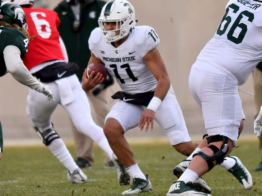 Connor Heyward (11) only had three carries last season for the Spartans, but he'll likely serve as running back LJ Scott's primary backup this fall.