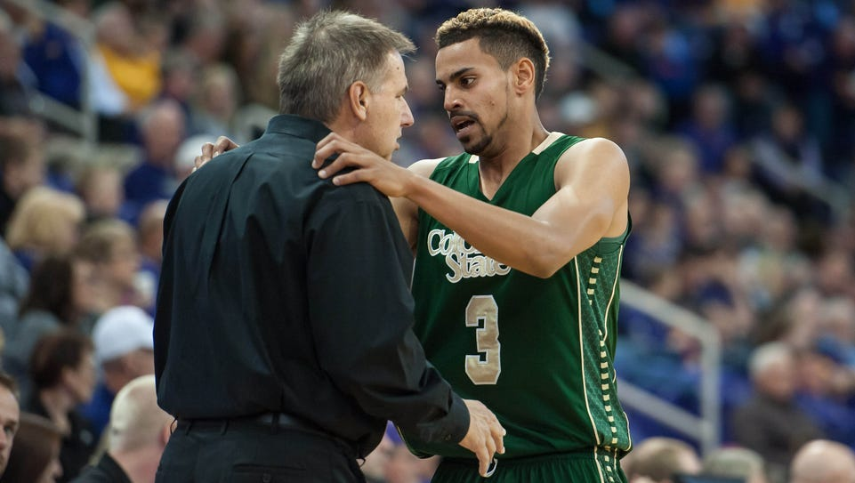 CSU coach Larry Eustachy talks with guard Gian Clavell