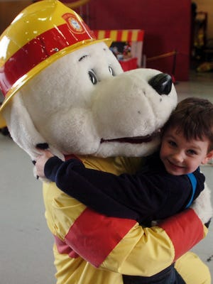Five-year-old Zeke Ellis 5, couldn't resist Sparky the Fire Dog at the annual Farmington Hills Fire Department open house.