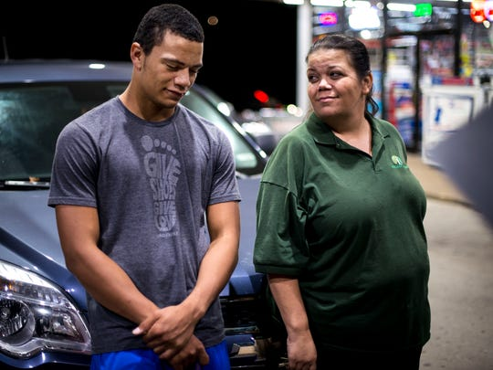 Shawn Murphy speaks with his mother Kim Murphy, who came to pick him up from a gas station after his car broke down on his way home from football practice, Tuesday, Oct. 25, 2016, in Nashville, Tenn.