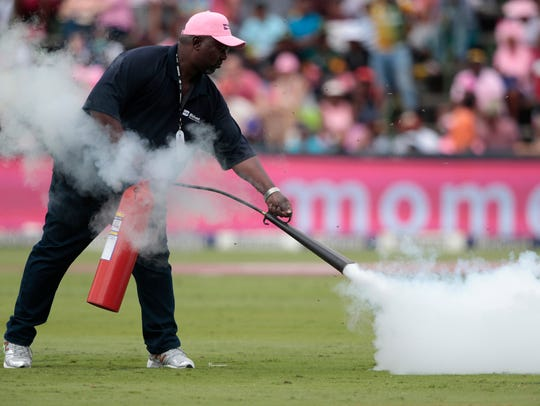 A field marshall fires an extinguisher onto a swarm