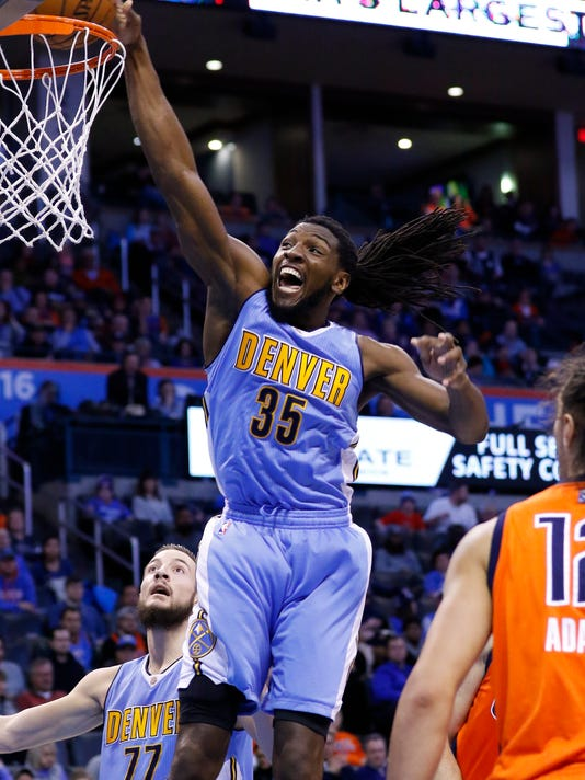 Denver Nuggets forward Kenneth Faried (35) goes up for a basket in front of Oklahoma City Thunder center Steven Adams (12) during the second quarter of an NBA basketball game in Oklahoma City, Sunday, Dec. 27, 2015. (AP Photo/Alonzo Adams)
