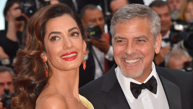 Actor George Clooney, left, and his wife Amal Clooney at the 69th Cannes Film Festival in Cannes, France.