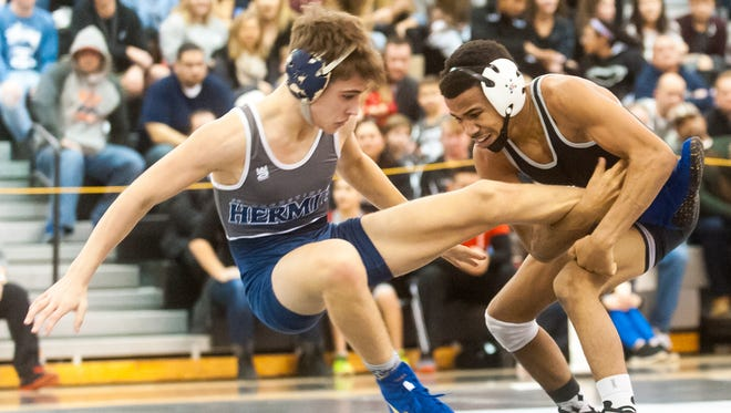 Egg Harbor Township's Terrell Coleman, right takes down St. Augustine's George Coleman during their 120-pound bout on Wednesday. The Eagles beat the Hermits 31-29.