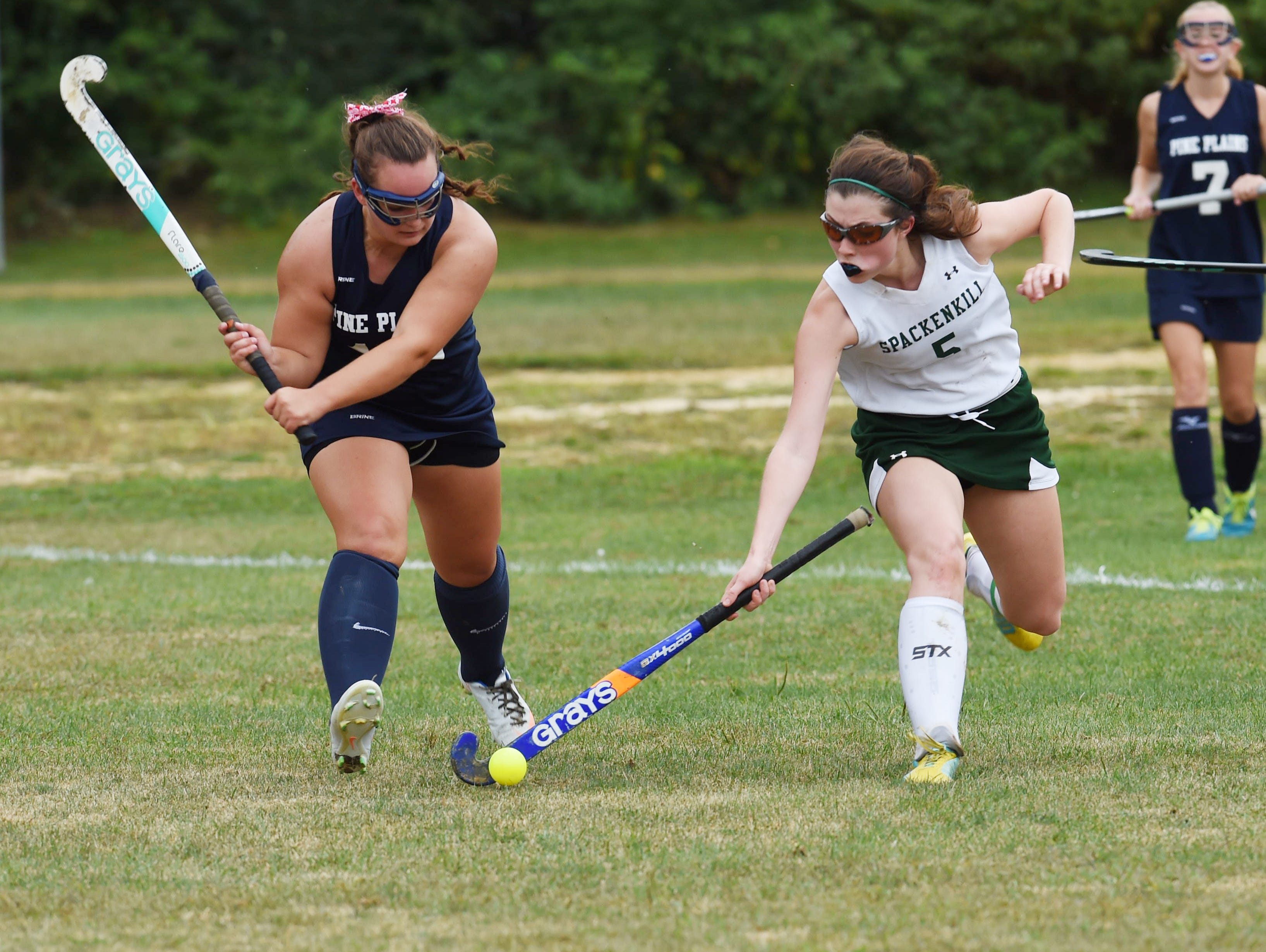 Spackenkill's Sarah Bowen, right, goes for the ball while Pine Plains' Meghan Murray, left, defends during Monday's game.
