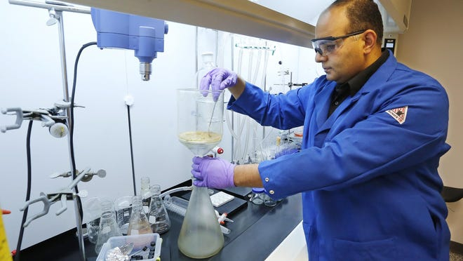 Mohammad Noshi collects the product of reaction in the lab of Akanocure Pharmaceuticals Monday, June 29, 2015, inside the Ross Enterprise Center, 3495 Kent Avenue in West Lafayette. Noshi is is COO, president of research and development, and founding partner of the pharmaceutical startup. Akanocure Pharmaceuticals recently won a $100,000 prize from FOUNDER.org