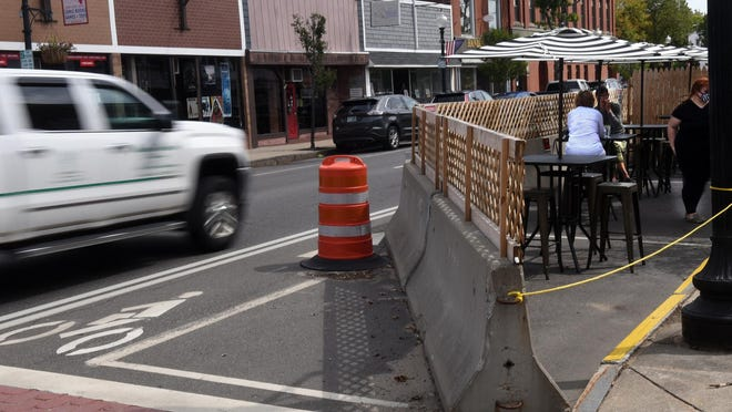 Downtown Rochester is seen with barriers in place to allow for outdoor dining. The city has 22 active COVID-19 cases as of Friday, Sept. 25, 2020, third most in New Hampshire.