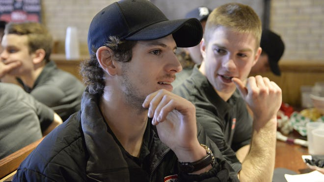 St. Cloud State hockey player and Hobey Baker finalist Nic Dowd (in hat) has been named an American Hockey Coaches Association Division I first team West All-American. Dowd was an All-NCHC first team pick, the NCHC Defensive Forward of the Year and the NCHC Student-Athlete of the Year. He is one of three finalists for the Hobey Baker Award.