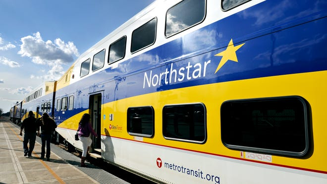 Passengers board an afternoon Northstar train Friday in Big Lake<137,2014/04/15,LeClair/c Mitch1>Friday<137><137>, April 11<137>.
