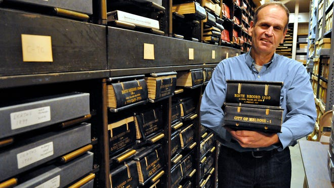 John Decker, director of archives at the Stearns History Museum, is the keeper of Stearns history. He is shown with birth and tax records on March 20.