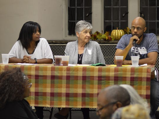From left, Tatia Harris, from the city of Knoxville, left; Rev. Janet Wolf, director of Children's Defense Fund Haley Farm and Nonviolent Organizing; and Andre Canty of the Highlander Center address a gathering at Church Street United Methodist Church on Sunday evening to talk about racial disparity in Knoxville and across the country.