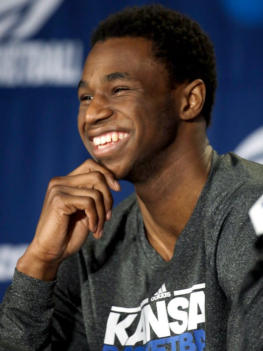 Kansas' Andrew Wiggins laughs at question during a news conference for the third-round game of the NCAA college basketball tournament Saturday, March 22, 2014, in St. Louis. Kansas is scheduled to play Stanford on Sunday. (AP Photo/Jeff Roberson)