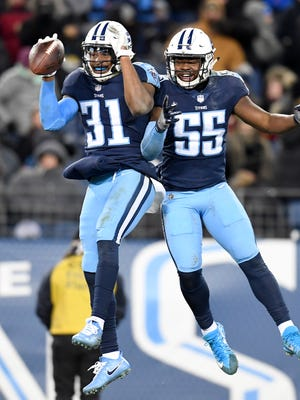 Titans safety Kevin Byard (31) and linebacker Jayon Brown (55) celebrate an interception by Byard during the second half Sunday.