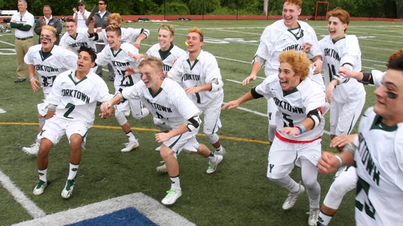 Yorktown players rush to celebrate after defeating John Jay 14-6 to win the Section 1 Class B boys lacrosse championship at Mahopac High School May 26, 2017
