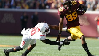 Minnesota wide receiver Rashad Still outruns Rutgers defensive back Austin Blessuan during the first half of an NCAA college football game Saturday, Oct. 22, 2016, in Minneapolis. (AP Photo/Stacy Bengs)