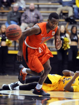 UTEP's Dominic Artis (1) scrambles to the ball as a Southern Mississippi player lies on the court during an NCAA college basketball game Thursday, Jan. 28, 2016, in Hattiesburg, Miss.